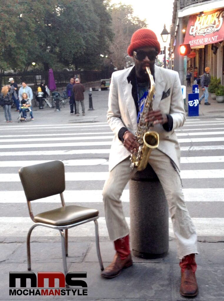 man playing saxophone in new orleans