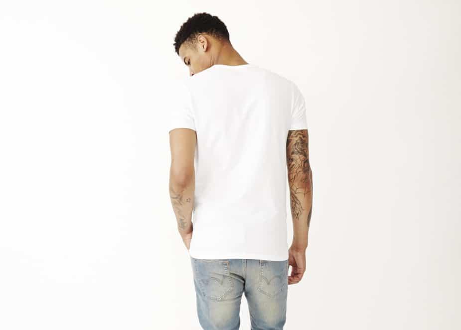 black man in white t-shirt