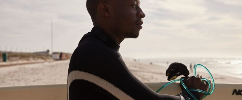 black man surfing