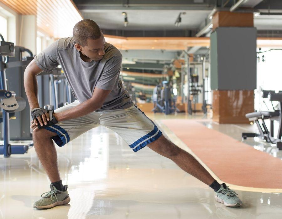 black man stretching before exercising